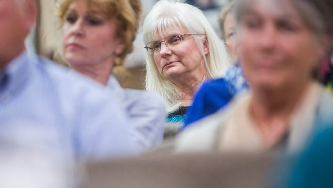 Janet Hill of Anderson listens intently during the Republican Party forum for eight candidates running for the South Carolina Senate District 3 seat on Monday, April 3, 2017, in Anderson.