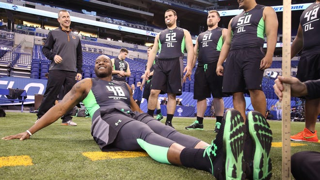 Ole Miss offensive lineman Laremy Tunsil gets measured at the NFL combine.