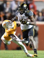 Tennessee defensive back Stephen Griffin tries to tackle