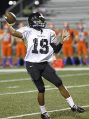 Kenwood quarterback Malcolm Perry throws a pass during the Border Wars Jamboree at Fort Campbell High School in 2013.