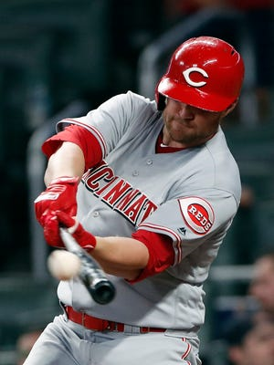 Cincinnati Reds right fielder Scott Schebler (43) connects on a solo-home run in the fifth Inning of a baseball game against the Atlanta Braves Monday, June 25, 2018, in Atlanta.