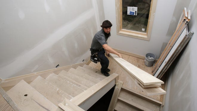 Will Hostetler, a carpenter with Larry Block Builders, works at a home under construction, in Pepper Pike, Ohio on Nov. 11.