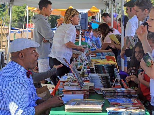 Children's author Bryan Collier greets fans during the second annual Chappaqua Children's Book Festival. This year's event will be held on Oct. 14.