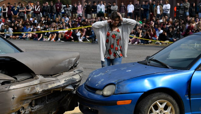 Franklin High School student Kaylee Wardlaw participates in a crash demo with the Franklin Fire, EMS, Police and Sheriff's office to illustrate the importance of not driving distracted Friday, March 23, 2018 in Franklin, Tenn.