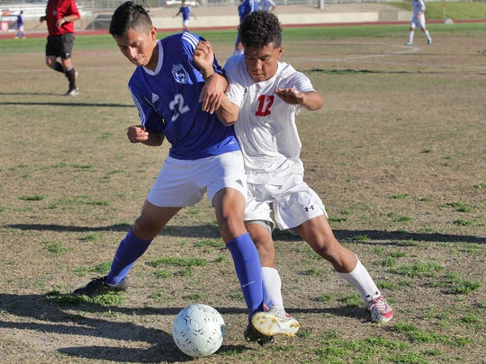 Jhonatan Urbina, 17, fights for control of the ball for Palm Desert High School during their loss to Century, February 19, 2016.