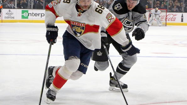 Florida Panthers right winger Jaromir Jagr (68) and Los Angeles Kings defenseman Brayden McNabb (3) chase the puck in the first period of an NHL hockey game in Los Angeles Saturday, Feb. 18, 2017. The Panthers won, 3-2. (AP Photo/Reed Saxon)