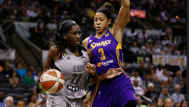 San Antonio Stars forward  Shameka Christon (left) drives to the basket as Los Angeles Sparks  forward  Candace Parker defends during the second half at AT&T Center in San Antonio on Aug. 10, 2014.