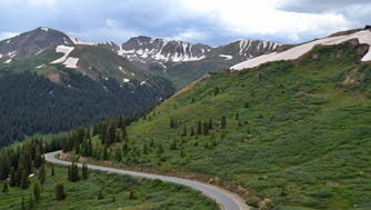 Colorado Independence Pass The highest paved state highway in Colorado, and also one of the most scenic, is called Independence Pass. Beautiful panoramic views of the Sawatch Range of the Rocky Mountains can be seen. Due to snow and harsh conditions, the road is closed in the winter.