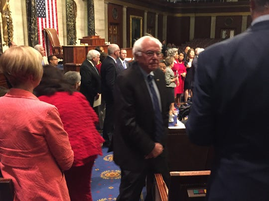 U.S. Sen. Bernie Sanders, I-Vt., center, arrives on the House floor Wednesday afternoon to join a sit-in protest to demand action on gun legislation.