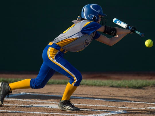 Castle's Hannah Tolley lays down a bunt against Gibson Southern during their 4A sectional championship game.