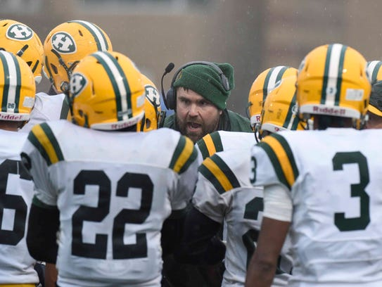 Harrison coach Jon Herstein fires up the defense for another goal line stand during a shutout victory over Riverview in the semifinal.