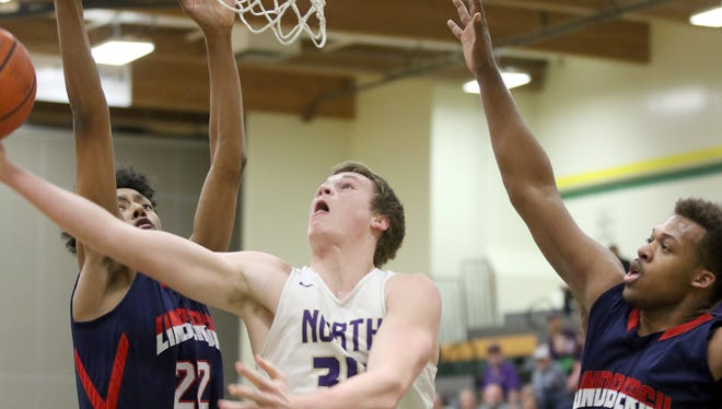 North Kitsap's Kohlten Barringer-Mahitka, center, goes up for a shot against Lindbergh in Wednesday's Class 2A West Central District semifinal game.
