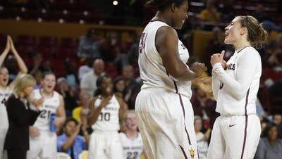 Ayanna Edwards, left, and Katie Hempen celebrate an Edwards' basket against Lehigh on Saturday.