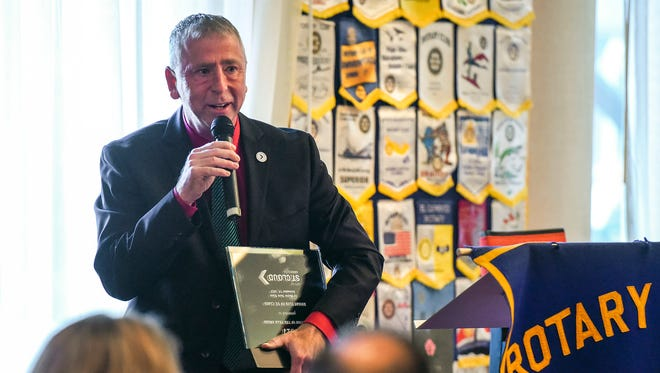 St. Cloud Mayor Dave Kleis presents the Reflection of the Year Award Tuesday, Dec. 19, to the Rotary Club of St. Cloud.