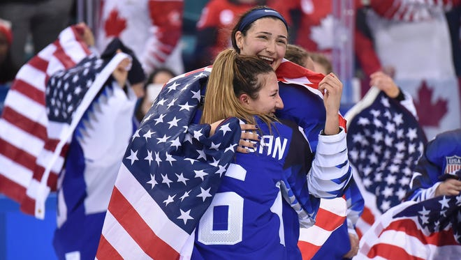 Feb 22, 2018; Gangneung, South Korea; United States defenseman Megan Keller (rear) and defenseman Kali Flanagan (6) celebrate after defeating Canada in the women's ice hockey gold medal match during the Pyeongchang 2018 Olympic Winter Games at Gangneung Hockey Centre. Mandatory Credit: Andrew Nelles-USA TODAY Sports
