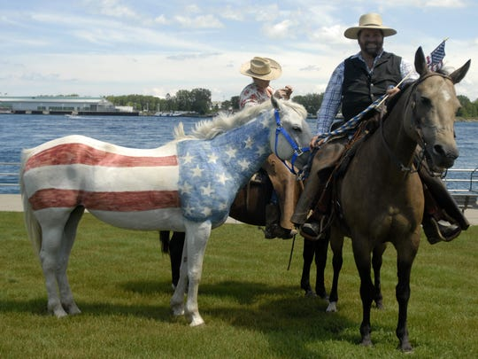 Dan Boden, of St. Clair gets into position with his horses during the 2012 filming of the original Blue Water Area promotional music video three years ago. ANDREW JOWETT/TIMES HERALD.