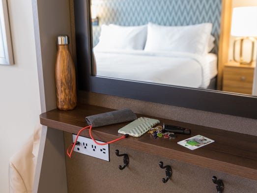 Hotels get rid of closets add other storage solutions for Designer room outlet