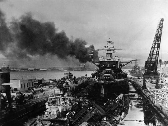 The jumbled mass of wreckage in front of the battleship USS Pennsylvania constitutes the remains of the destroyers USS Downes and USS Cassin, bombed by the Japanese on Dec. 7, 1941, during the raid on Pearl Harbor.