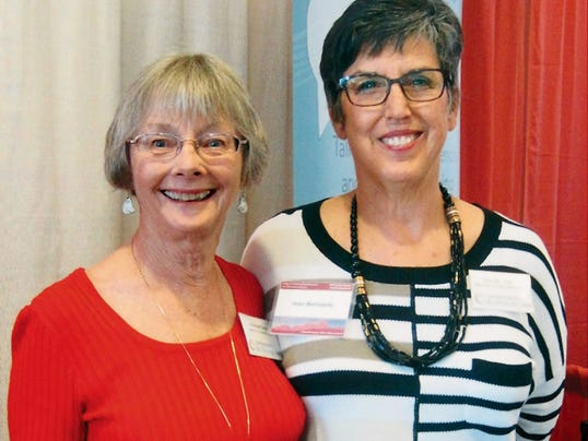 "Adrienne Dare, left, and Jean Berlowitz are both action team leaders for Compassion & Care in Silver City and Las Cruces. The two attended the NMSU Dean's Health Symposium, ""A Beautiful Death: What Will You Choose?"" on May 1 in Las Cruces. There were over 400 in attendance at the symposium. Courtesy Photo"