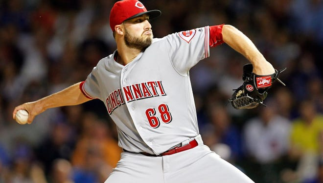 Cincinnati Reds starting pitcher Tim Adleman (68) delivers a pitch during the first inning against the Chicago Cubs at Wrigley Field.