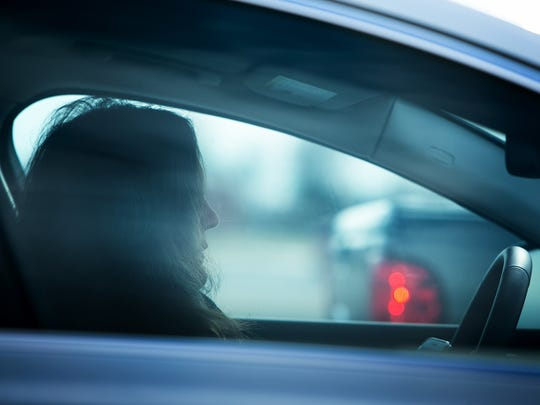 A motorist checks her phone at a traffic light along Route 13. The Delaware Office of Highway Safety (OHS) and Delaware law enforcement agencies are urging motorists to focus on driving and eliminate the use of hand-held cell phones to engage in texting and other distracting behaviors while driving.
