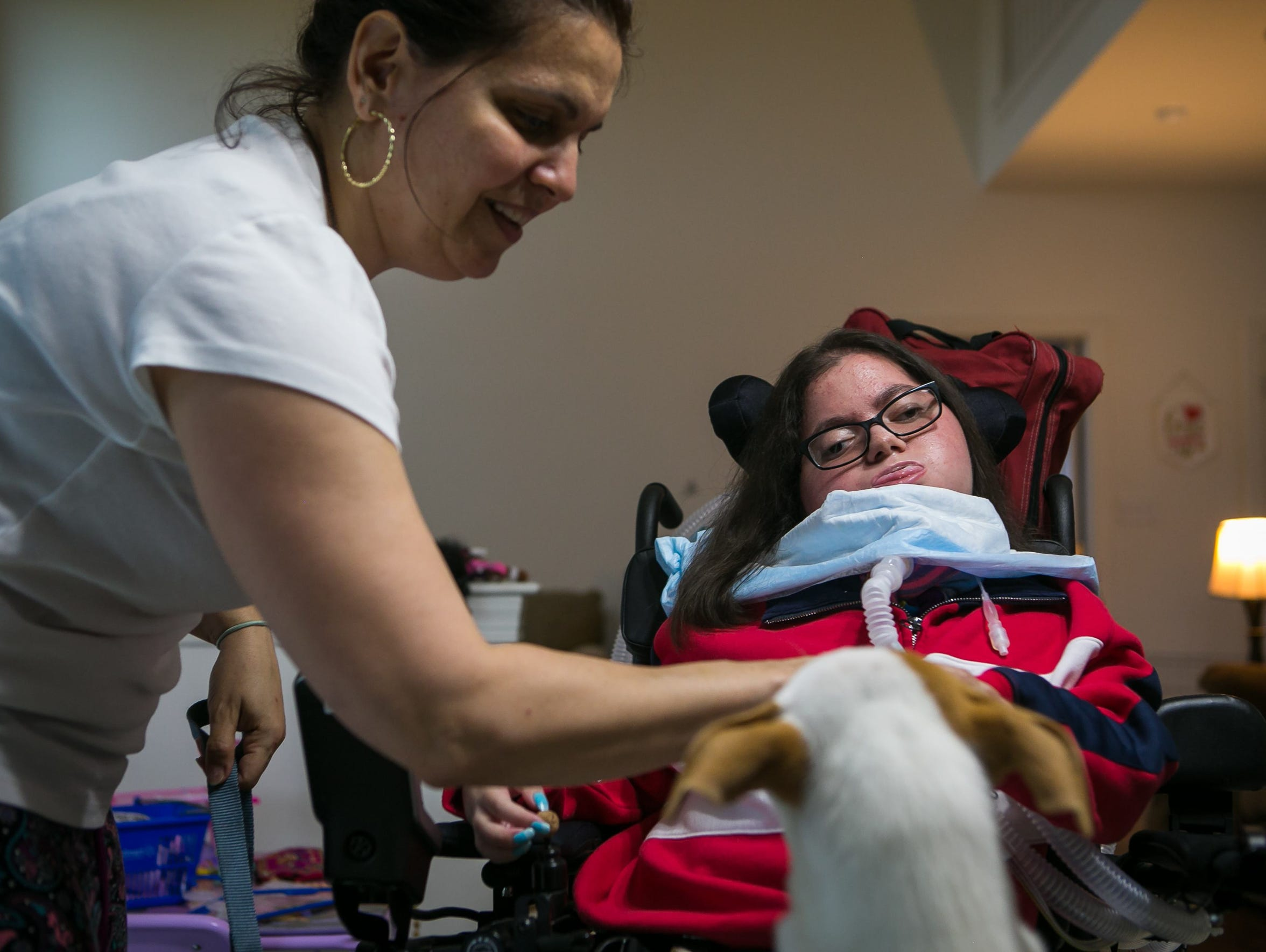 Nicole Albano, who graduated from Glasgow High School on June 6, spends five minutes a day training her new puppy to be a service dog.