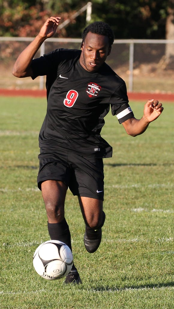 Nyack's Wismento Saint-Germain advances the ball during