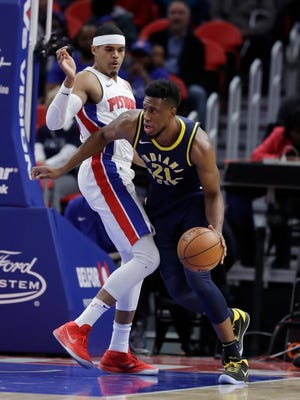 Indiana Pacers forward Thaddeus Young (21) drives around Detroit Pistons forward Tobias Harris during the first half of an NBA basketball game, Wednesday, Nov. 8, 2017, in Detroit.
