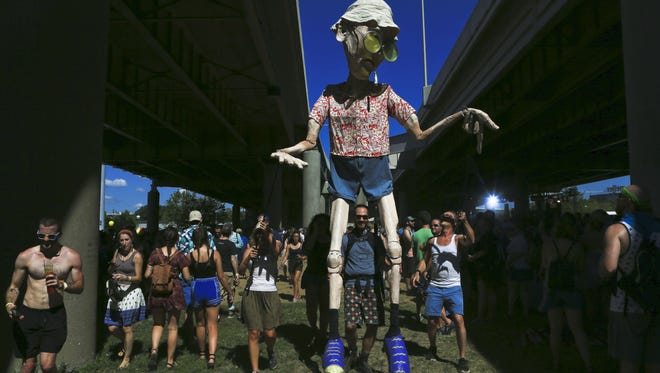 The Squallis puppet of Hunter S. Thompson roamed the grounds at Forecastle Festival last year.