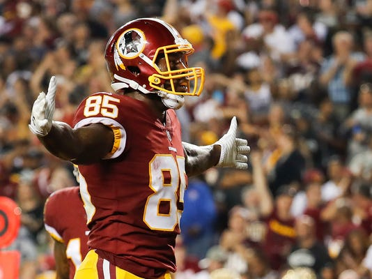 Washington Redskins tight end Vernon Davis (85) celebrates his touchdown during the first half of an NFL football game against the Oakland Raiders in Landover, Md., Sunday, Sept. 24, 2017. (AP Photo/Pablo Martinez Monsivais)