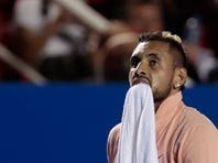 Australia's Nick Kyrgios walks off the court to boos from the crowd, after retiring from a match against France's Ugo Humbert during the first round of the Mexican Open tennis tournament in Acapulco, Mexico, Tuesday, Feb. 25, 2020. (AP Photo/Rebecca Blackwell)