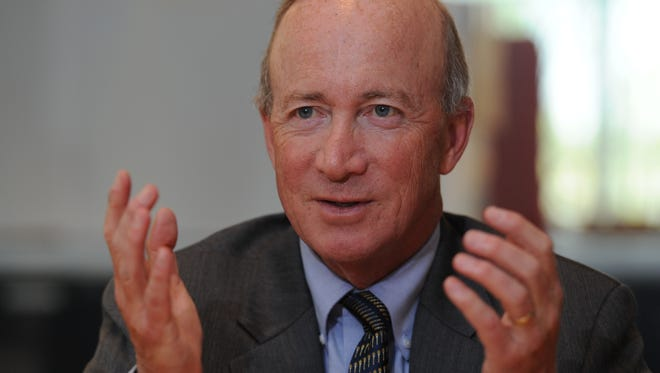 Mitch Daniels, president of Purdue and former governor of Indiana, criticized President Trump's order banning some refugees from entering the country.