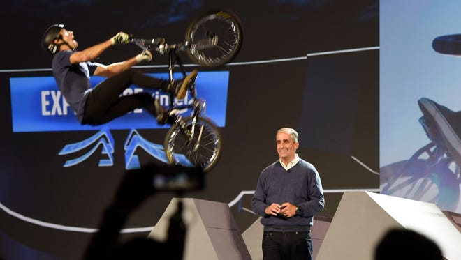 Intel chief executive Brian Krzanich delivering a keynote address at CES in Las Vegas as a biker does a stunt on stage. Intel's Curie sensors track height and speed, mapping the data in 3D.