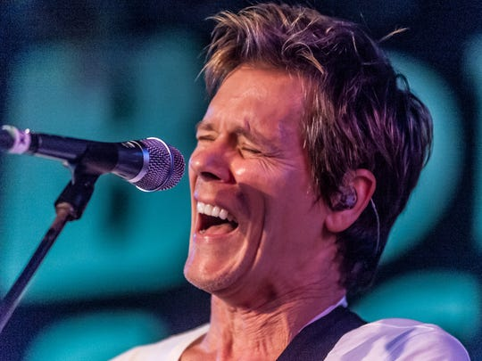 Actor Kevin Bacon, in his role as guitarist and singer with the Bacon Brothers band.