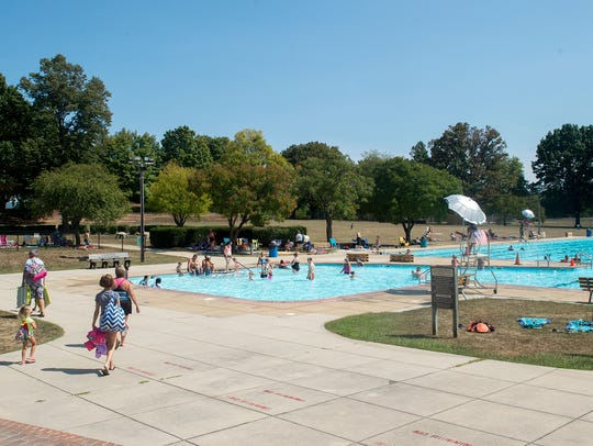 Families swim and enjoy the pool one last time on Monday,