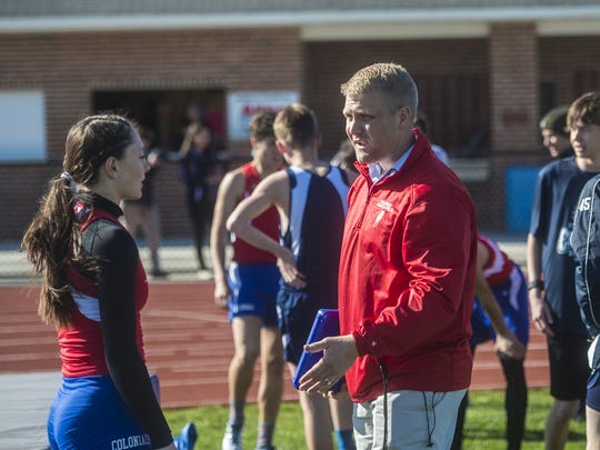 New Oxford coach Jason Warner gives feedback to a student during the Dallastown-New Oxford track meet on March 29, 2016 at New Oxford High School.