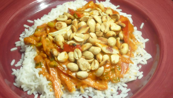 Flavorful rice dish inspired by cookbook of Pakistani cuisine: Vegetarian Kausar Karachi-Style Rice.