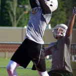 Aiken junior cornerback Tim Williams, right, lines up on defense in a passing practice on July 18.