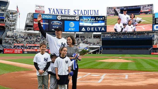 New York Yankees first baseman Mark Teixeira waves to the fans with his wife, Leigh, and children Jack, Addy and Will during a ceremony to honor Teixeira on his retirement before the baseball game against the Baltimore Orioles, Sunday, Oct. 2, 2016, in New York.