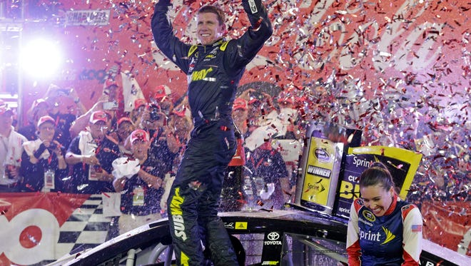 Carl Edwards celebrates in Victory Lane after winning the NASCAR Sprint Cup series auto race Sunday at Charlotte Motor Speedway in Concord, N.C.