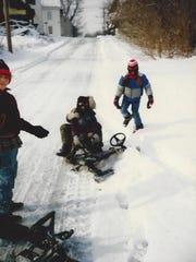 Children sled on NE Fourth Street in Milford in the
