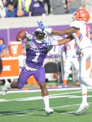 ACU defensive back Cydney Calvin (1) breaks up a pass intended for Sam Houston's Nathan Stewart. The No. 4 Bearkats beat ACU 44-35 Saturday, Nov. 11, 2017 at Wildcat Stadium.