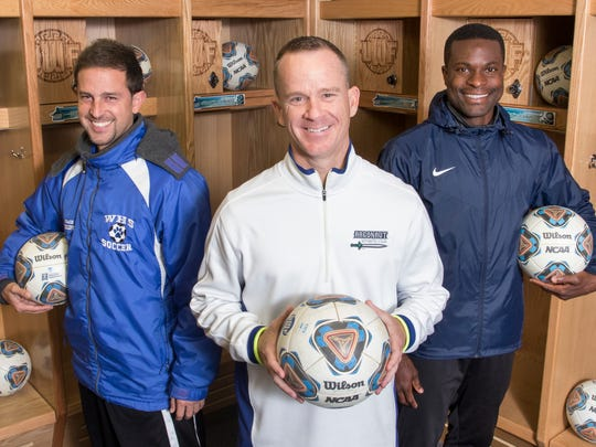 Booker T. Washington High School coach Felipe Lawall, left to right, UWF head coach Bill Elliot, and Tate High School coach Richard Dixon pose in the soccer locker room at the University of West Florida in Pensacola on Tuesday. Lawall and Dixon both played soccer for coach Elliot at UWF and now are coaches themselves.