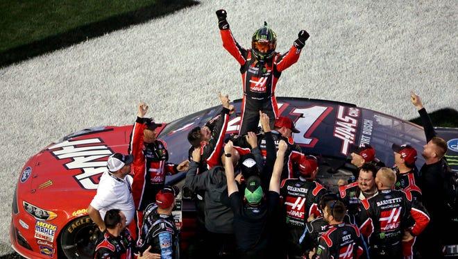 Kurt Busch celebrates with  his No. 41 Stewart-Haas Racing team after winning the 2017 Daytona 500 Sunday.