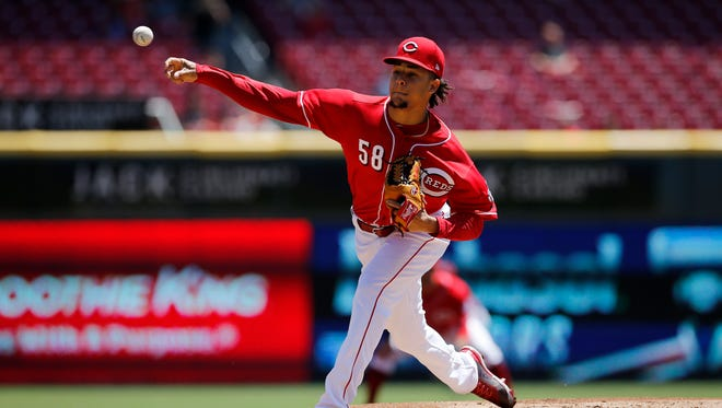 Cincinnati Reds starting pitcher Luis Castillo (58) delivers a pitch in the top of the first inning of the MLB National League game between the Cincinnati Reds and the Pittsburgh Pirates at Great American Ball Park in downtown Cincinnati on Thursday, May 24, 2018.