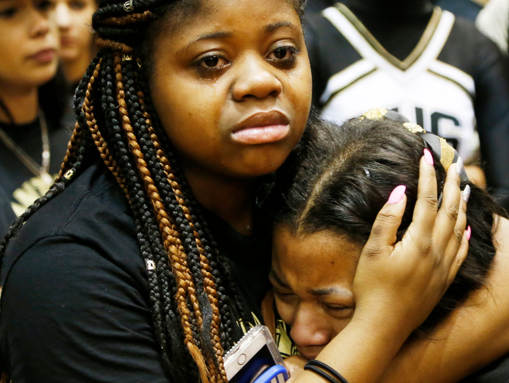 Darea Warner, left, and Victoria Burgess cry after Griffith lost to Marion 60-58 in the Class 3A basketball semistate Wednesday, March 23, 2016, Lafayette Jefferson High School.