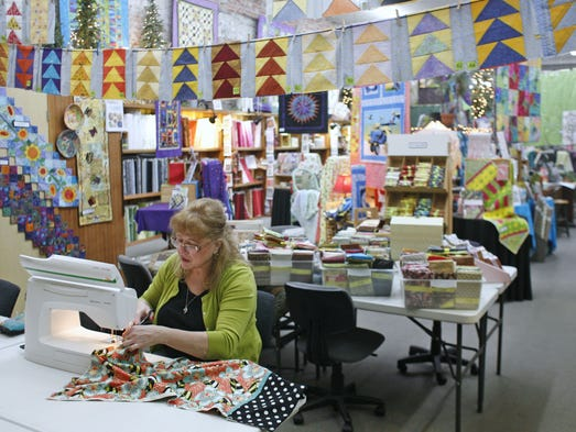 Carole Kurth works on making a pillowcase at Greenbaum's Quilted Forest on Friday, Feb. 5, 2010. She is sewing the pillow cases as part of the One Million pillow case project that is sponsored by a national magazine.