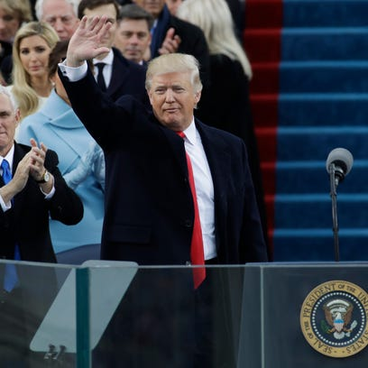 Vice President Mike Pence, left, applauds as President