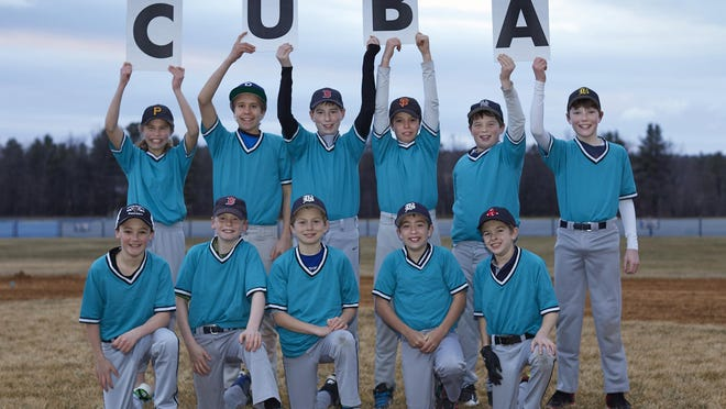 A team of local youth baseball players will be travelling to Cuba this April. The group will be one of the first U.S. baseball teams to play on the island. Front row, left to right: Ollie Pudvar, Eli Bostwick, Nolan Simon, Cyrus Perkinson, August Rinehart. Back row, left to right: Anna Jenemann, Carter Monks, Tate Agnew, Will Gumbrel, Ozzie Kost, Andrew Goodrich.