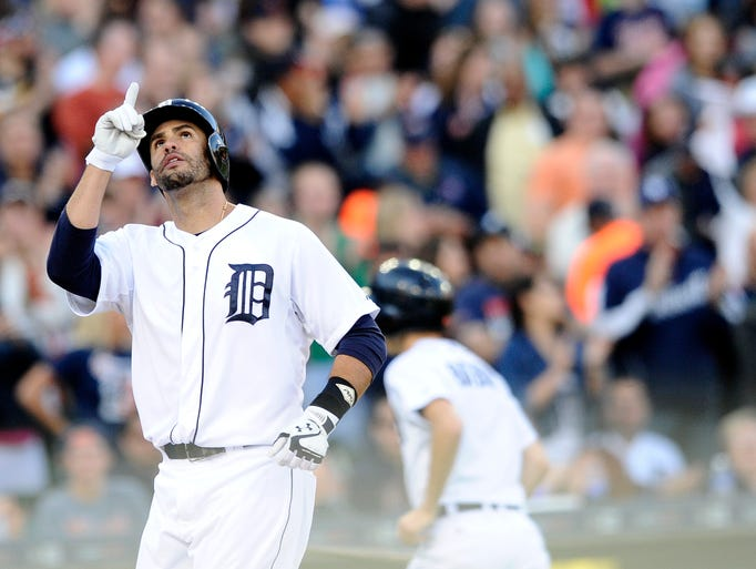 Tigers' J.D. Martinez (28) celebrates as he crosses